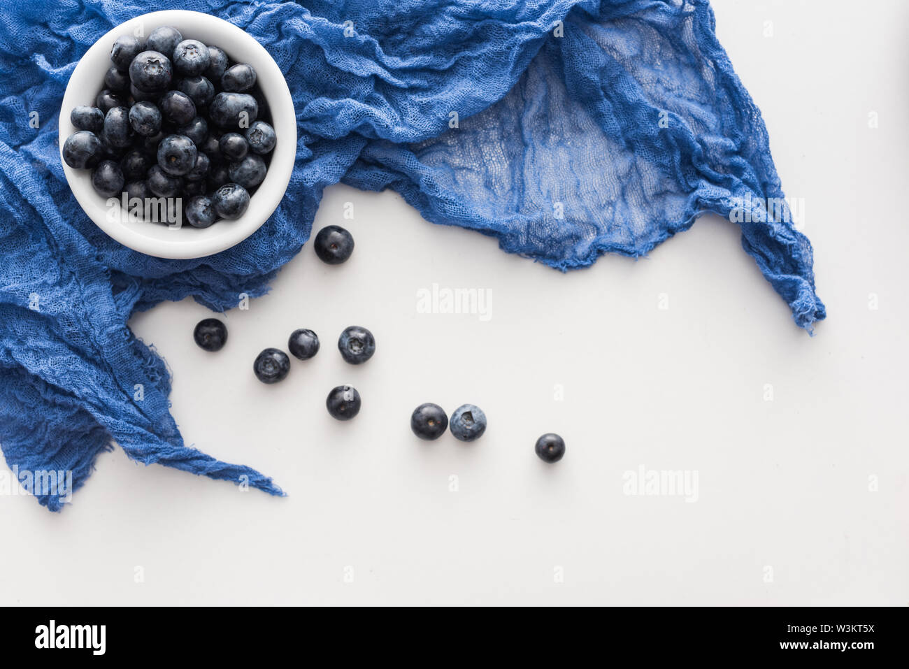 Top View Of Sweet Blueberries On Blue Bowl With Blue Cloth Stock