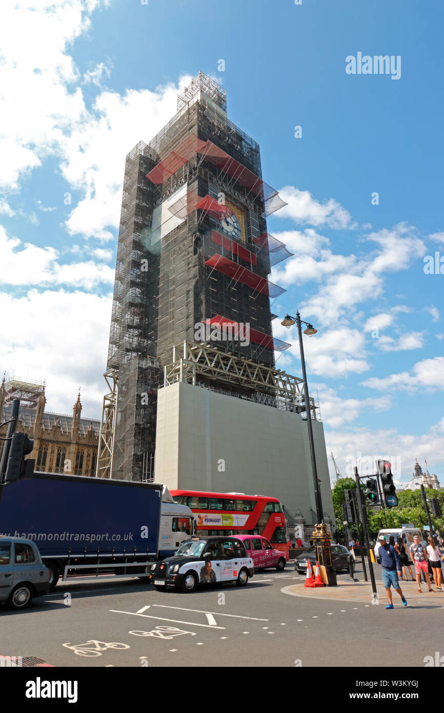 Elizabeth Tower or Big Ben encased in scaffolding for renovation work. It is the bell tower of the Houses of Parliament in Westminster London England Stock Photo