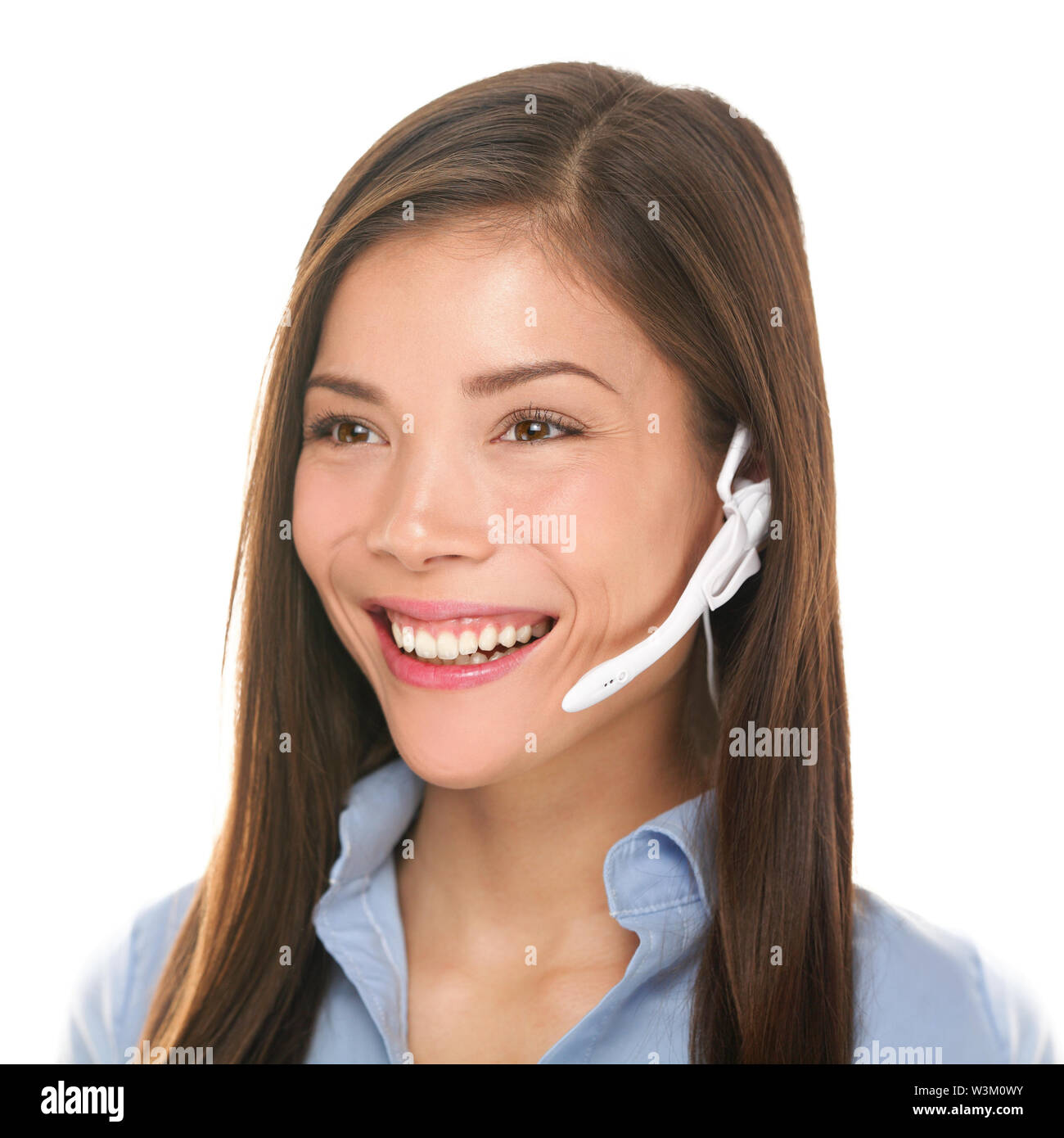 Headset customer service woman talking friendly smiling happy in call center on isolated on white background. Beautiful young mixed race Caucasian / Asian Chinese business woman working at hotline. Stock Photo