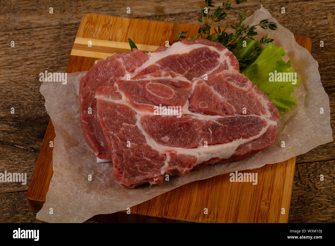 Raw pork steak ready for grill - Stock Image