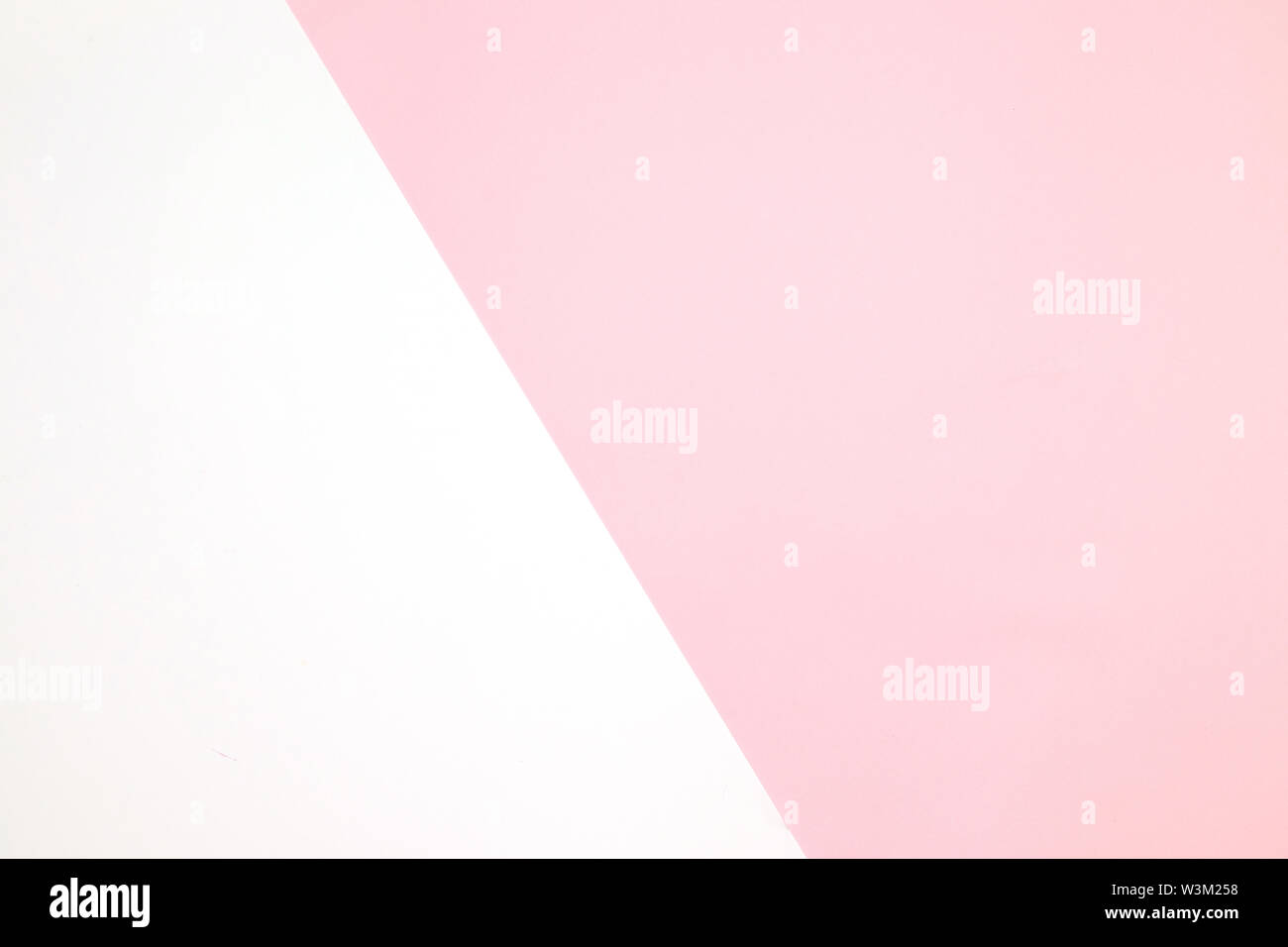 Pink and white texture in a fashionable pastel color with a top view, minimal concept, flat lay. - Stock Image