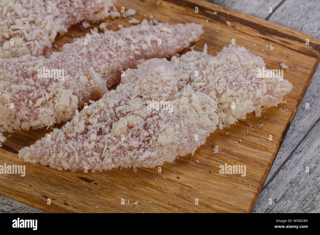 Raw chicken cutlet ready for cooking - Stock Image