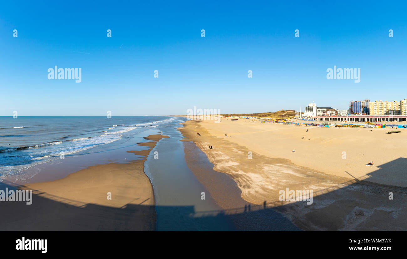 Sunny day on North sea beach in Netherlands in Scheveningen, tourist and vacation destination - Stock Image