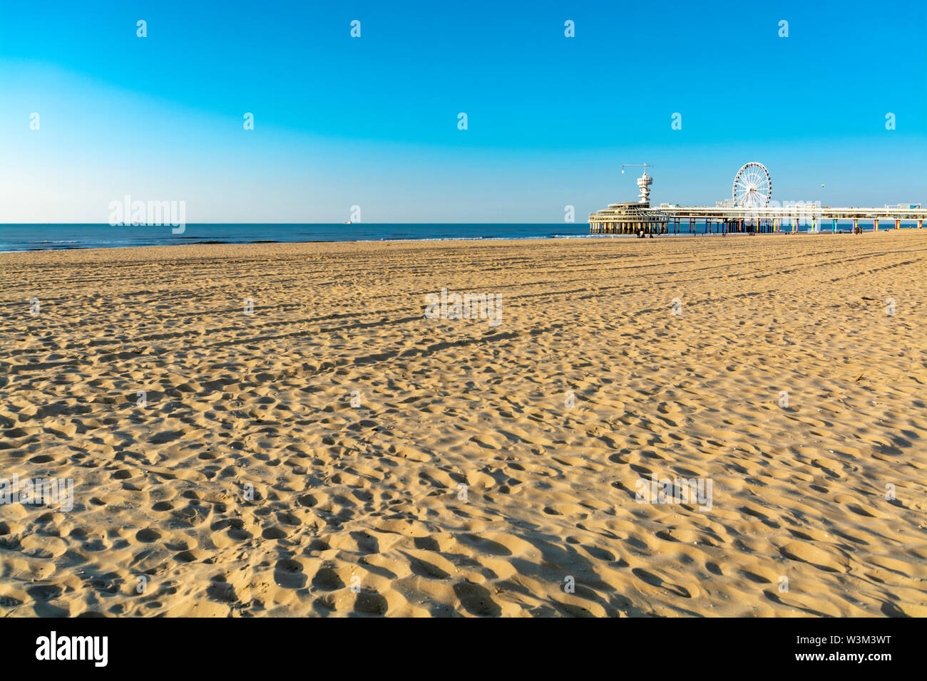 Sunny day on North sea beach in Netherlands in Scheveningen, tourist and vacation destination in Europe - Stock Image