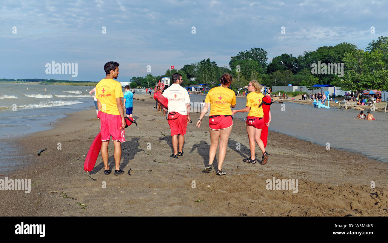 Lifeguards patrol what is left of the Fairport Harbor, Ohio beach after Lake Erie record water levels coupled with winds closed it to swimming in July - Stock Image