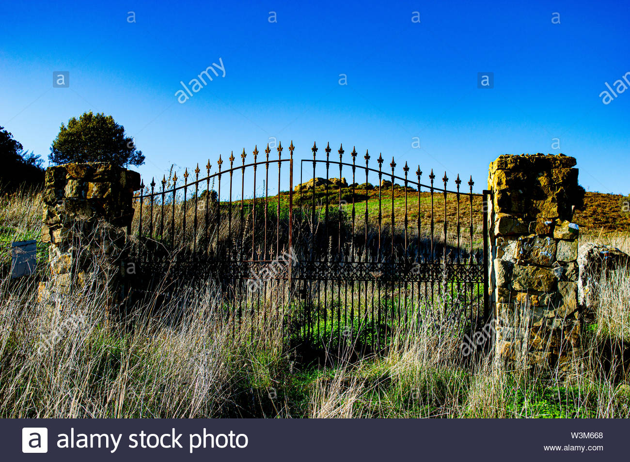iron gate in the middle of the hill - Stock Image