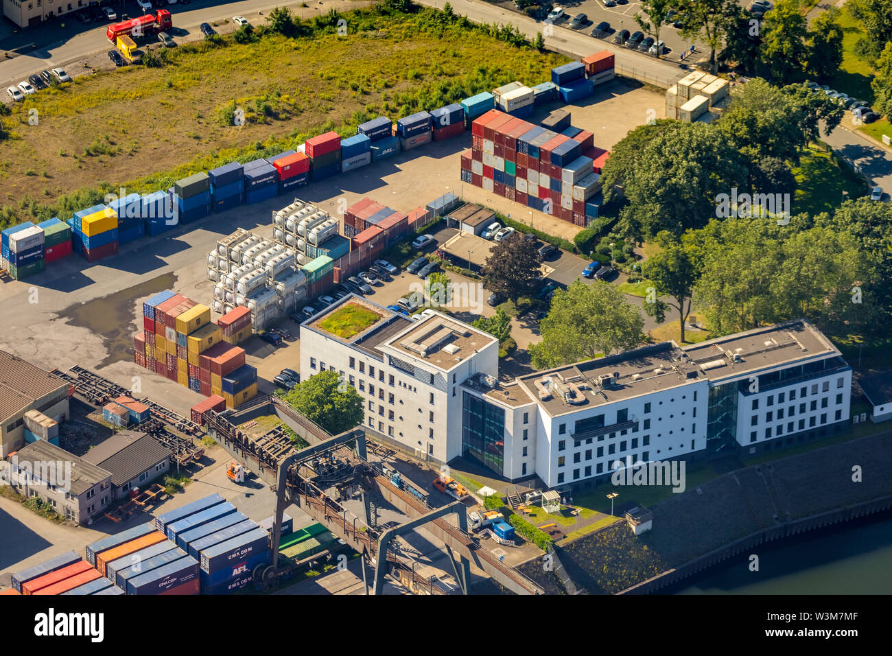Aerial photograph of the headquarters Duisburger Hafen AG (duisport) of Duisburger Hafen Duisport AG an der Ruhr with Ruhr estuary into the Rhine in o Stock Photo