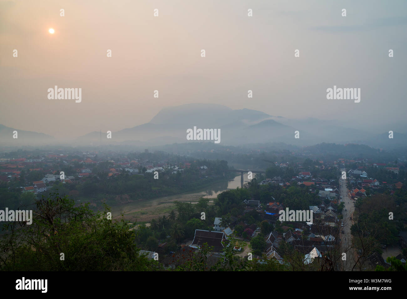 The city of Luang Prabang in Laos viewed from above from the Mount Phousi (Phou Si, Phusi, Phu Si) at sunrise. Copy space. Stock Photo