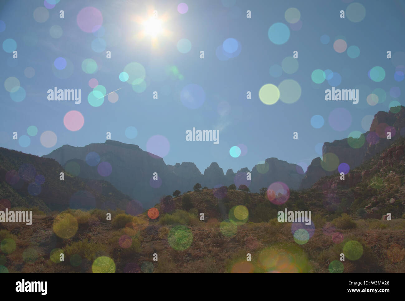 Mountains in sun light. Colorful bokeh - Stock Image