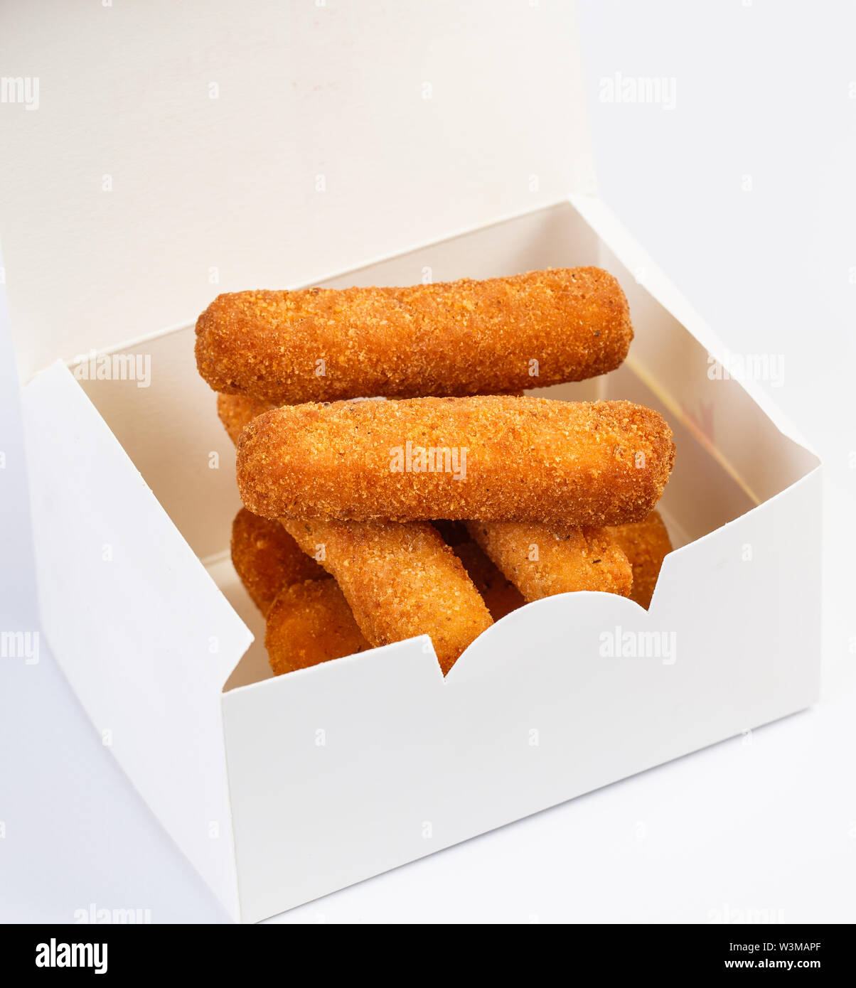 Fried cheese sticks in a white box. - Stock Image