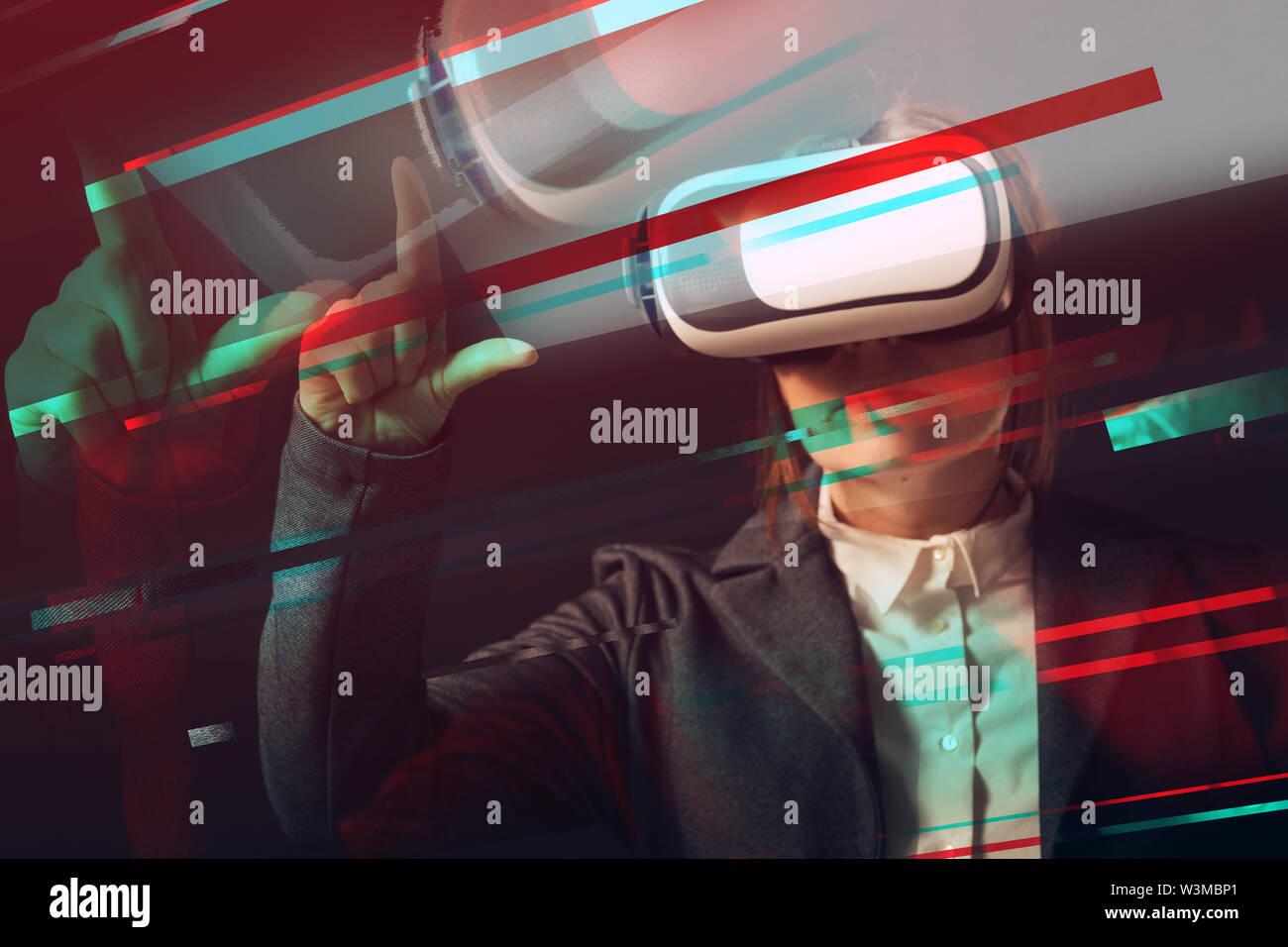 Businesswoman wearing virtual reality headset, digitally enhanced image - Stock Image