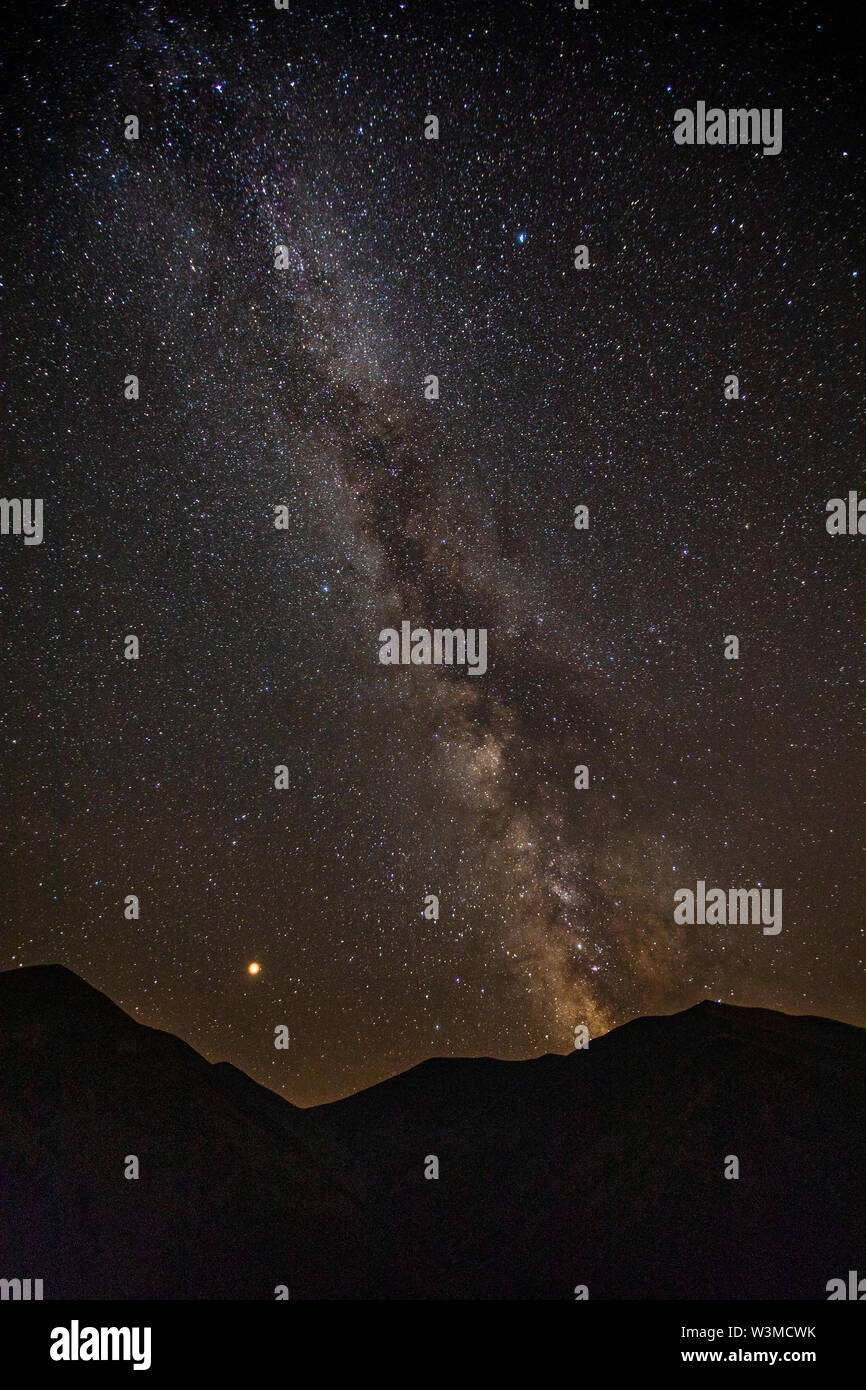 Milky Way galaxy over mountains - Stock Image