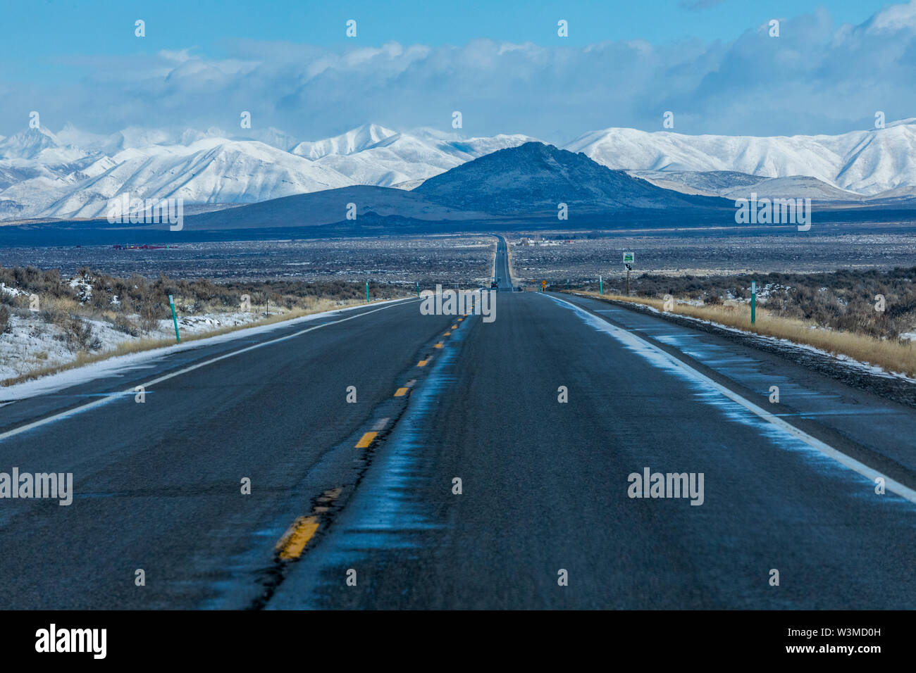 Road to snowcapped mountains in Sun Valley, Idaho, USA - Stock Image