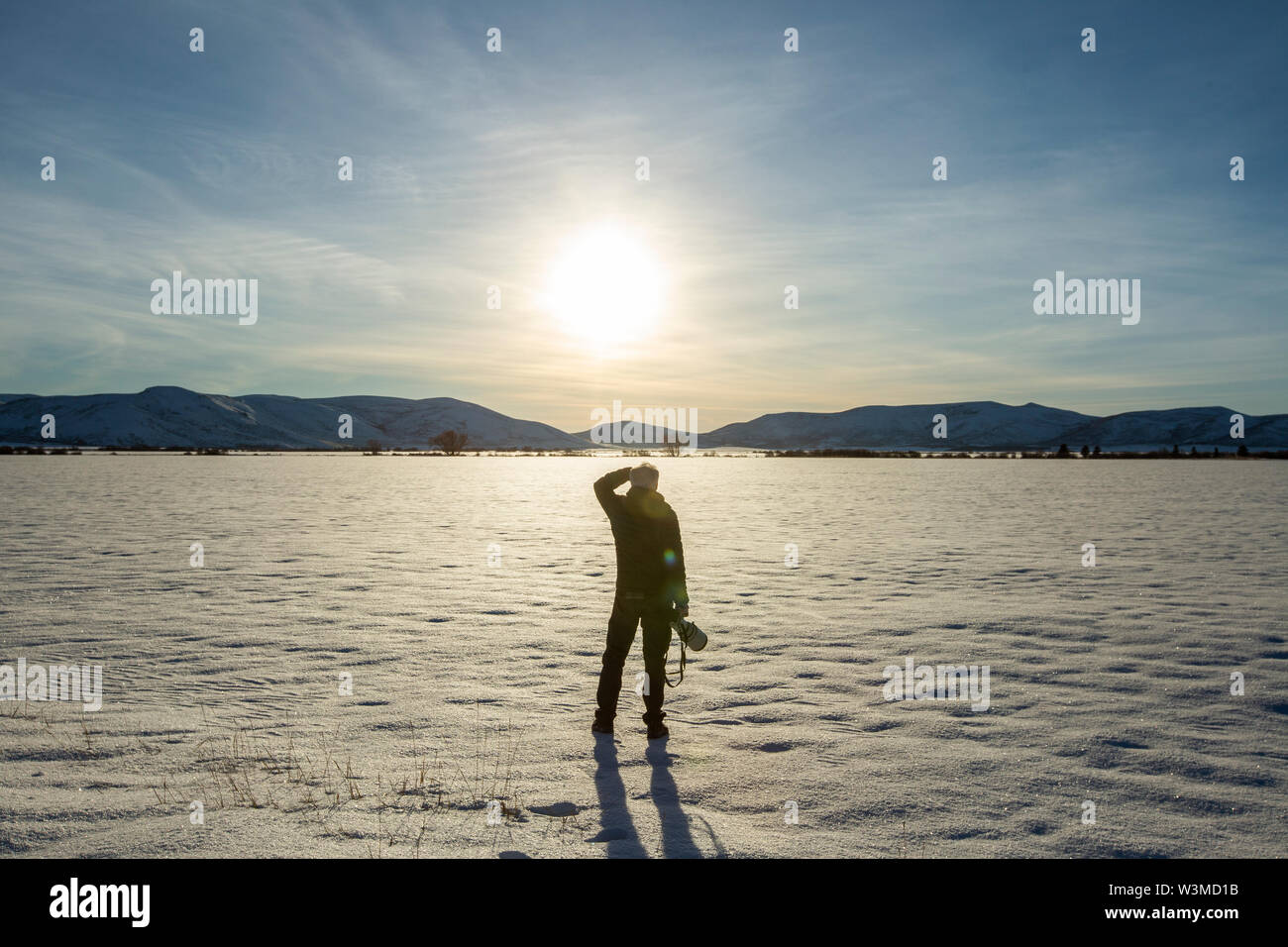 Senior man with camera in snow field in Picabo, Idaho - Stock Image