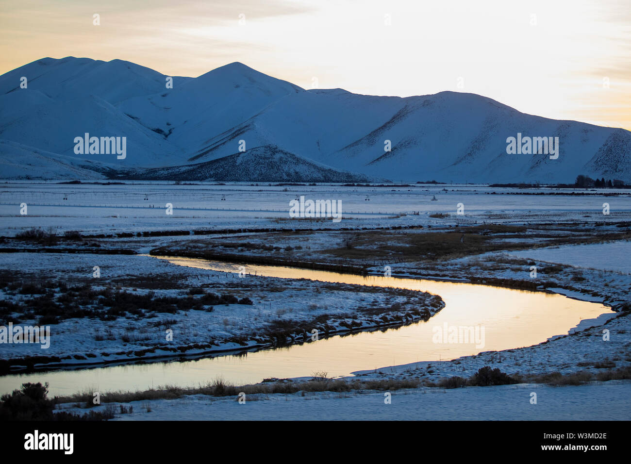 River and mountains at sunrise in Picabo, Idaho - Stock Image