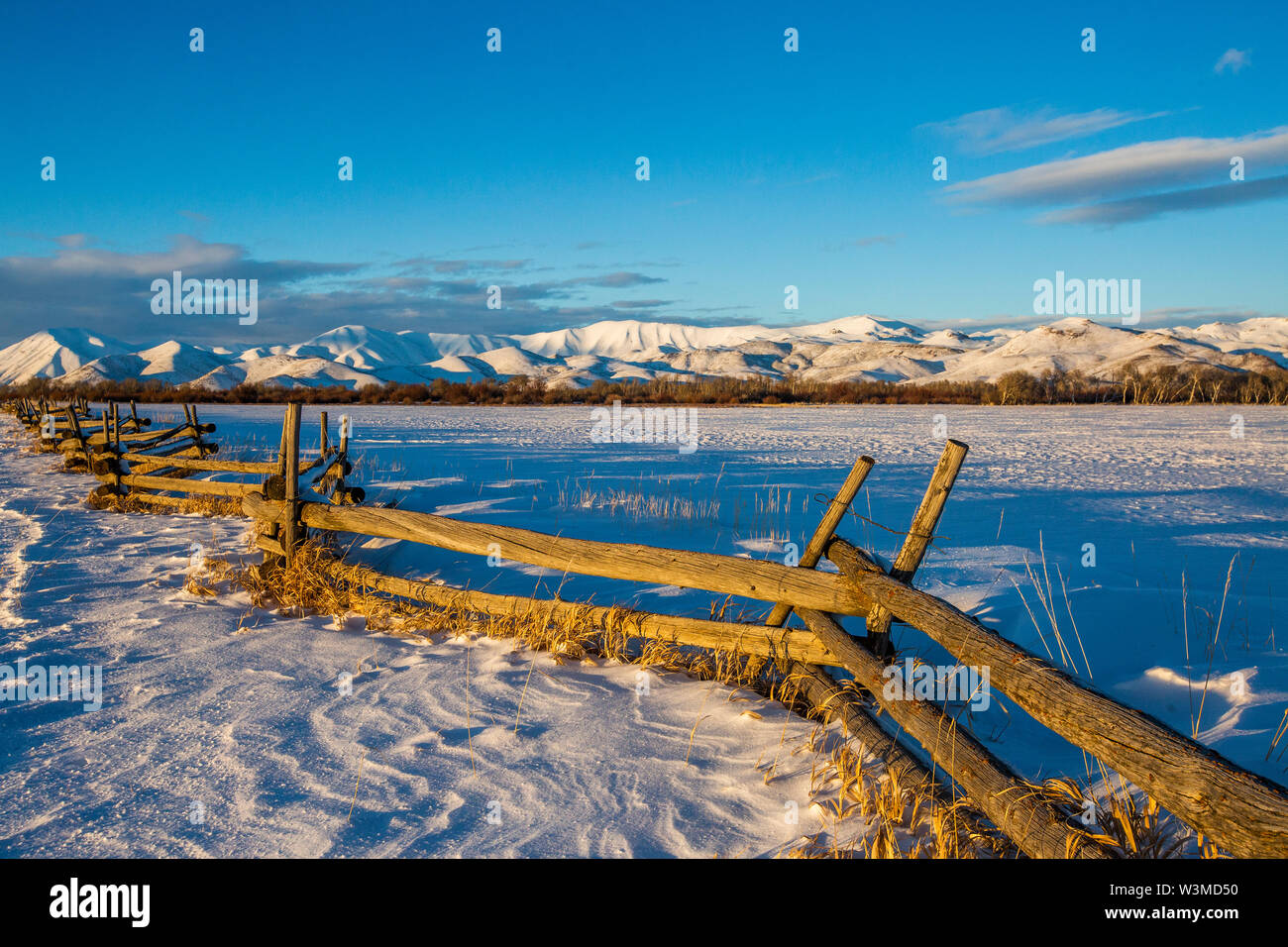 Wooden fence and snow field in Picabo, Idaho - Stock Image