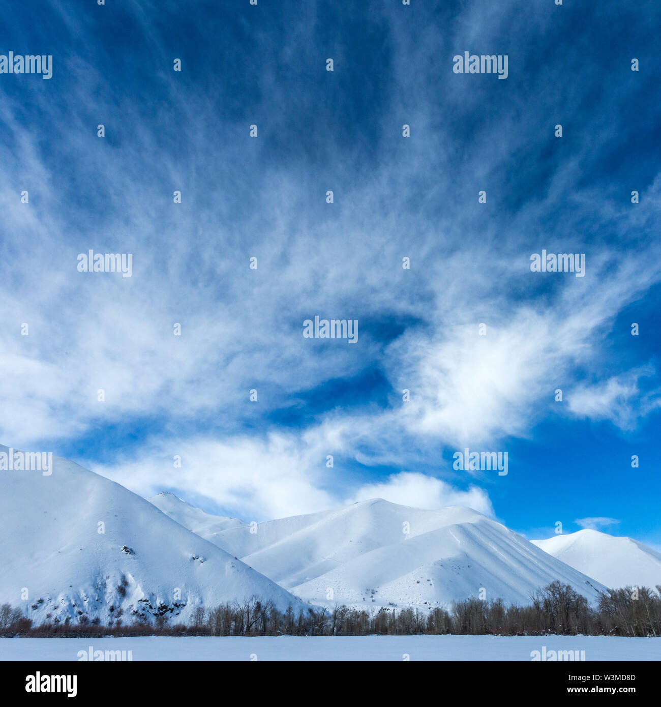Snow covered mountains under clouds in Sun Valley, Idaho, USA - Stock Image