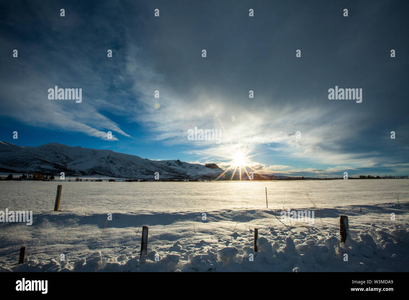 Snow field and mountain at sunrise in Picabo, Idaho - Stock Image