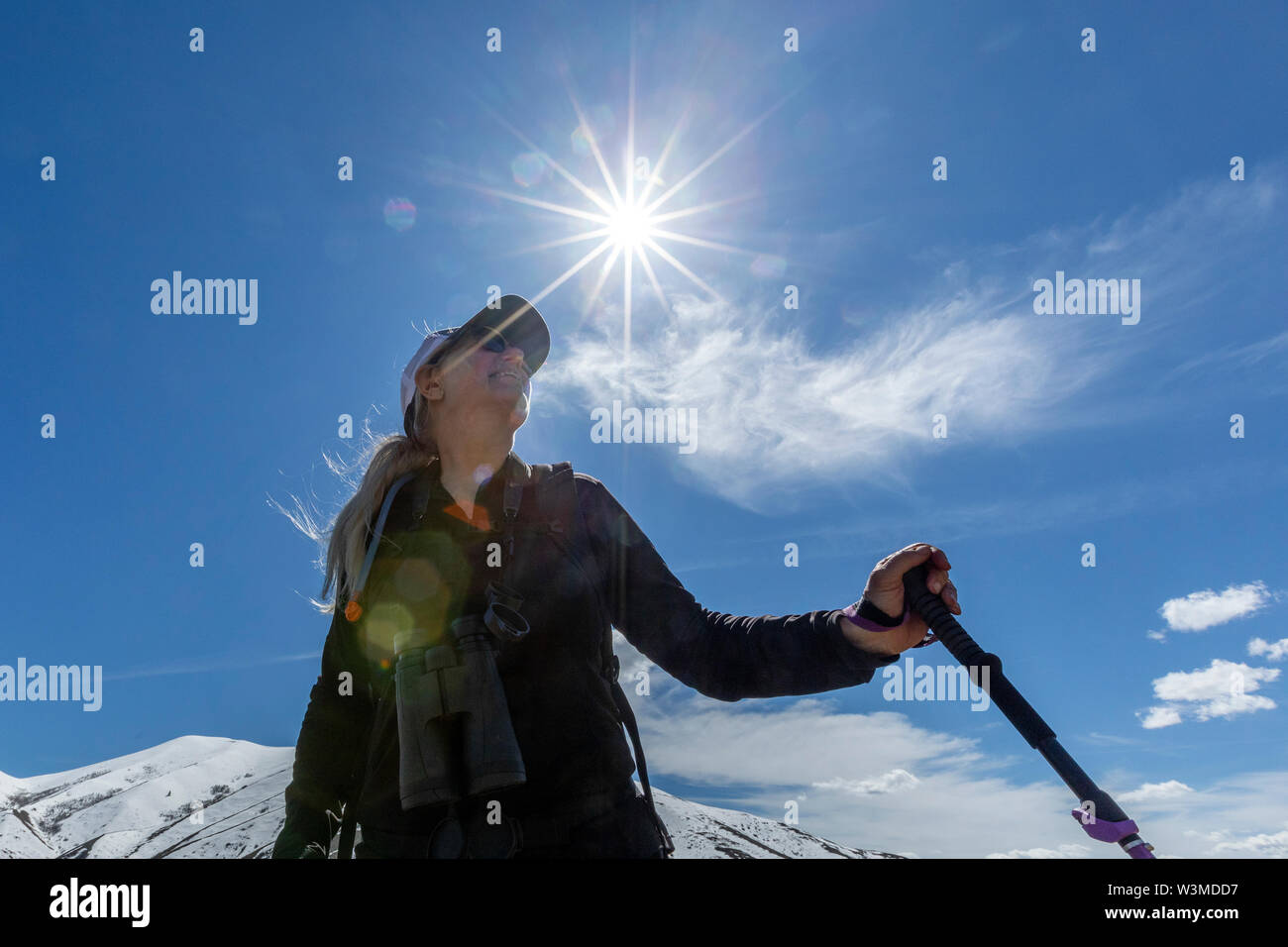 Low angle view of hiker on snow covered mountain - Stock Image