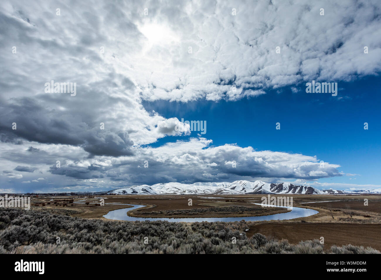 River and mountains under clouds in Picabo, Idaho - Stock Image
