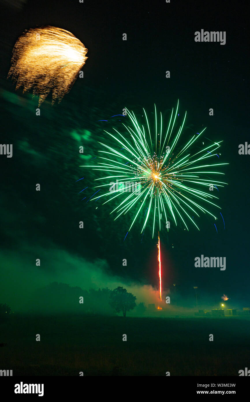 Fireworks going off over Missouri Southern State University in Joplin, Missouri on July 4, 2019 Stock Photo