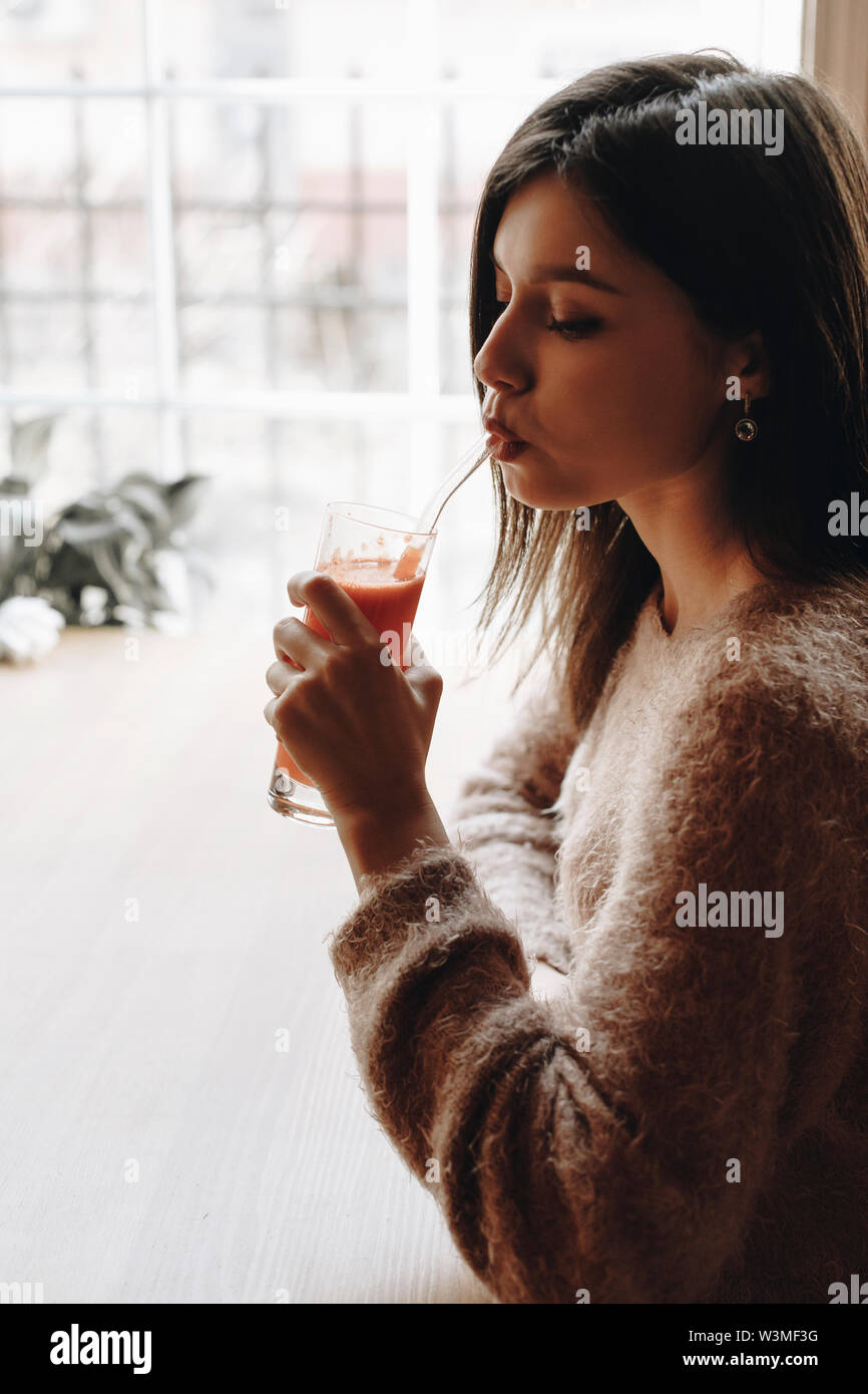 Young woman drinking juice - Stock Image
