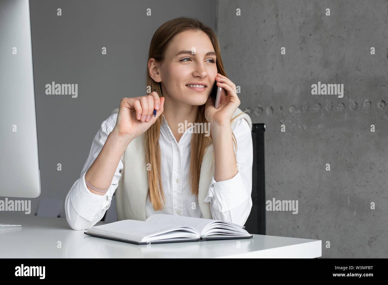 Businesswoman talking on phone - Stock Image