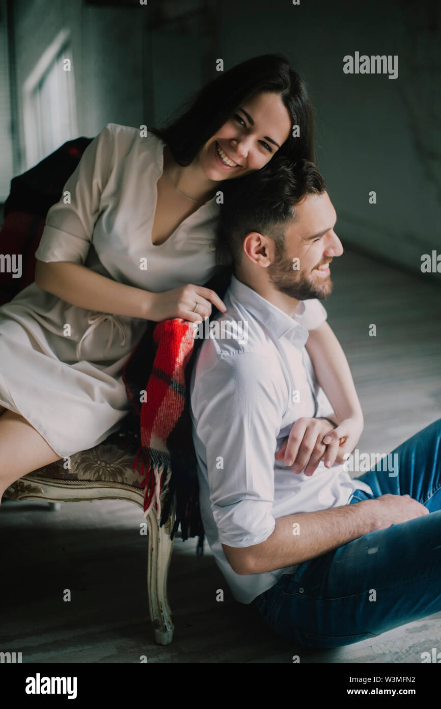 Smiling young couple with sofa - Stock Image