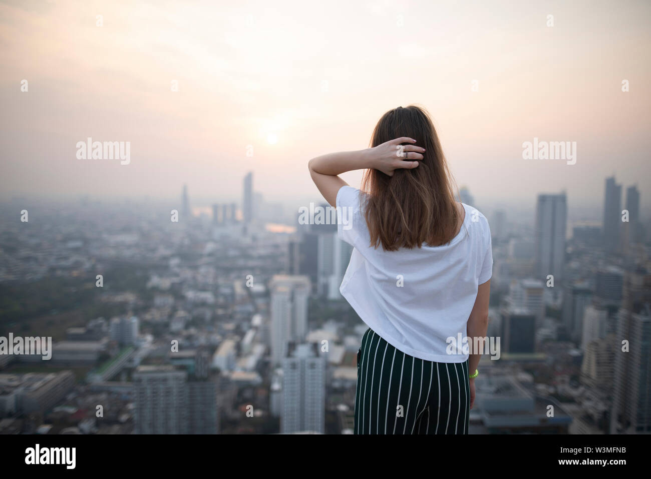 Young woman and cityscape of Bangkok, Thailand - Stock Image