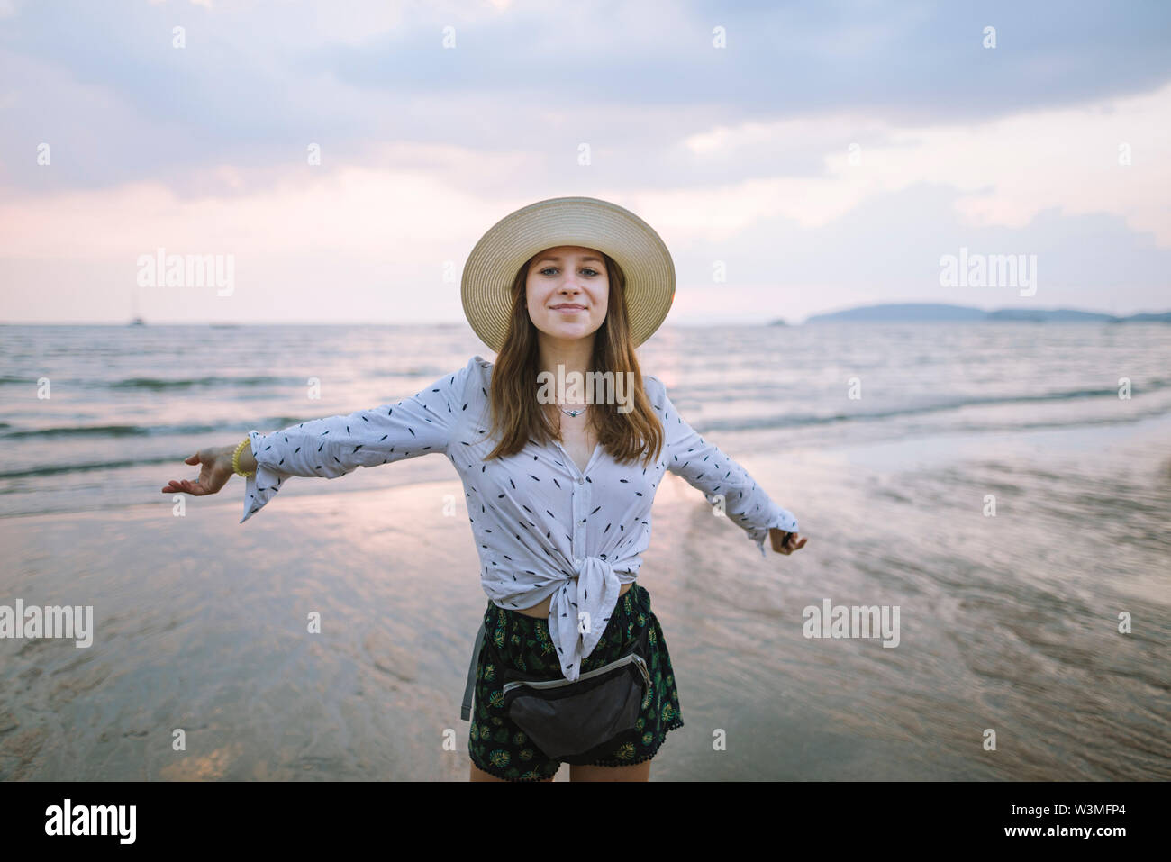 Young woman in sun hat on beach in Krabi, Thailand - Stock Image