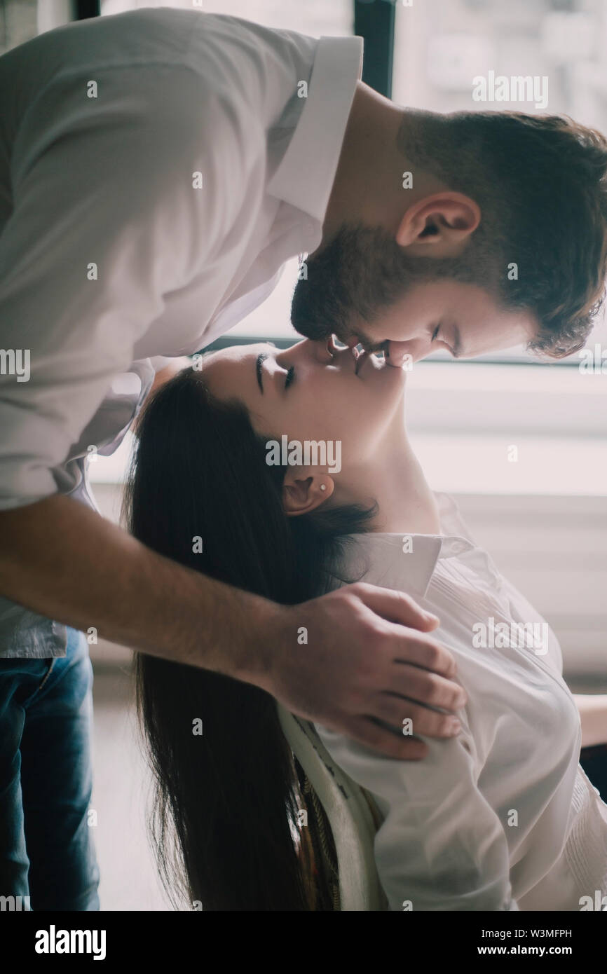Young couple face to face with their eyes closed - Stock Image