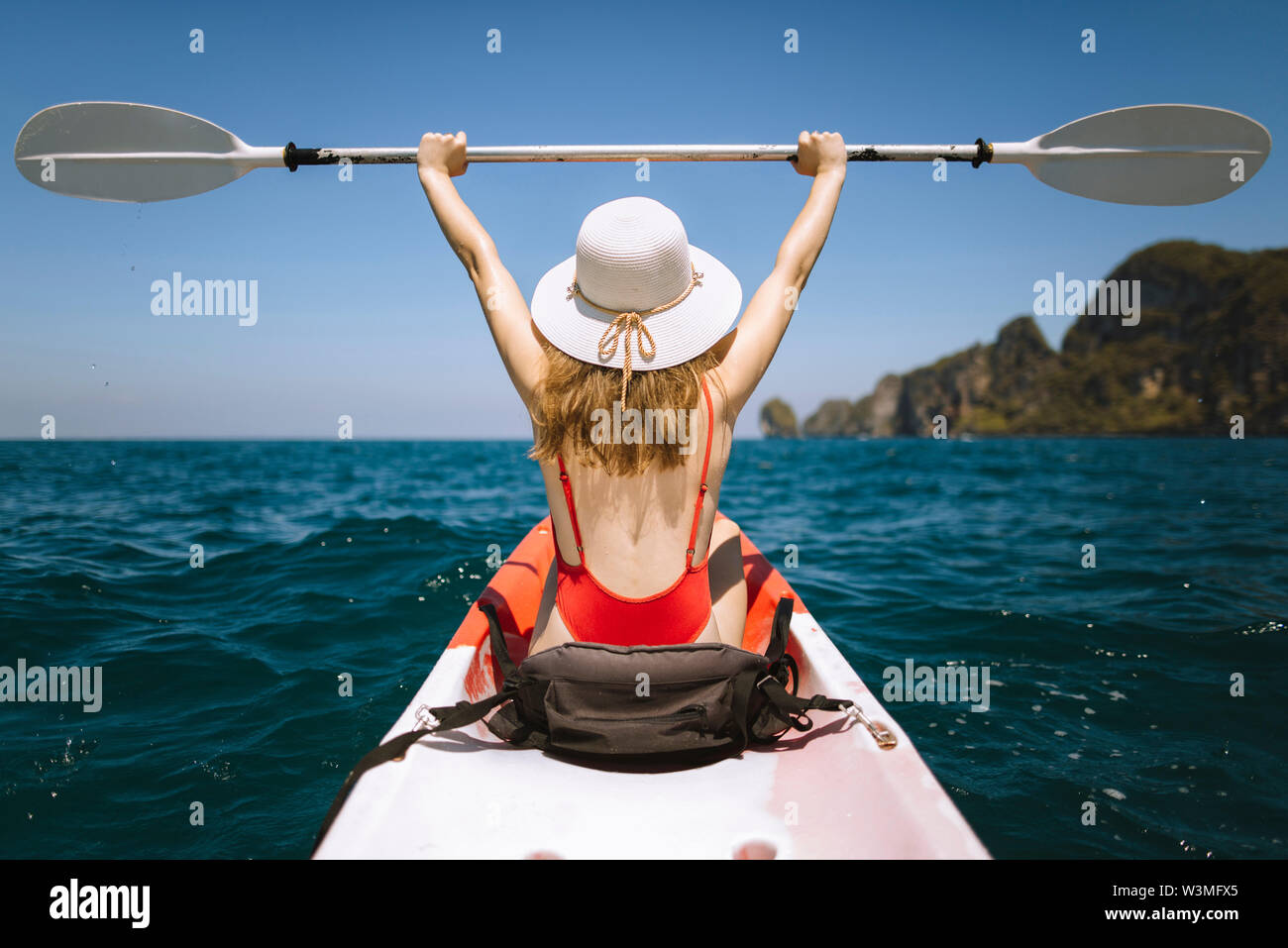 Young woman in kayak on sea in Krabi, Thailand - Stock Image