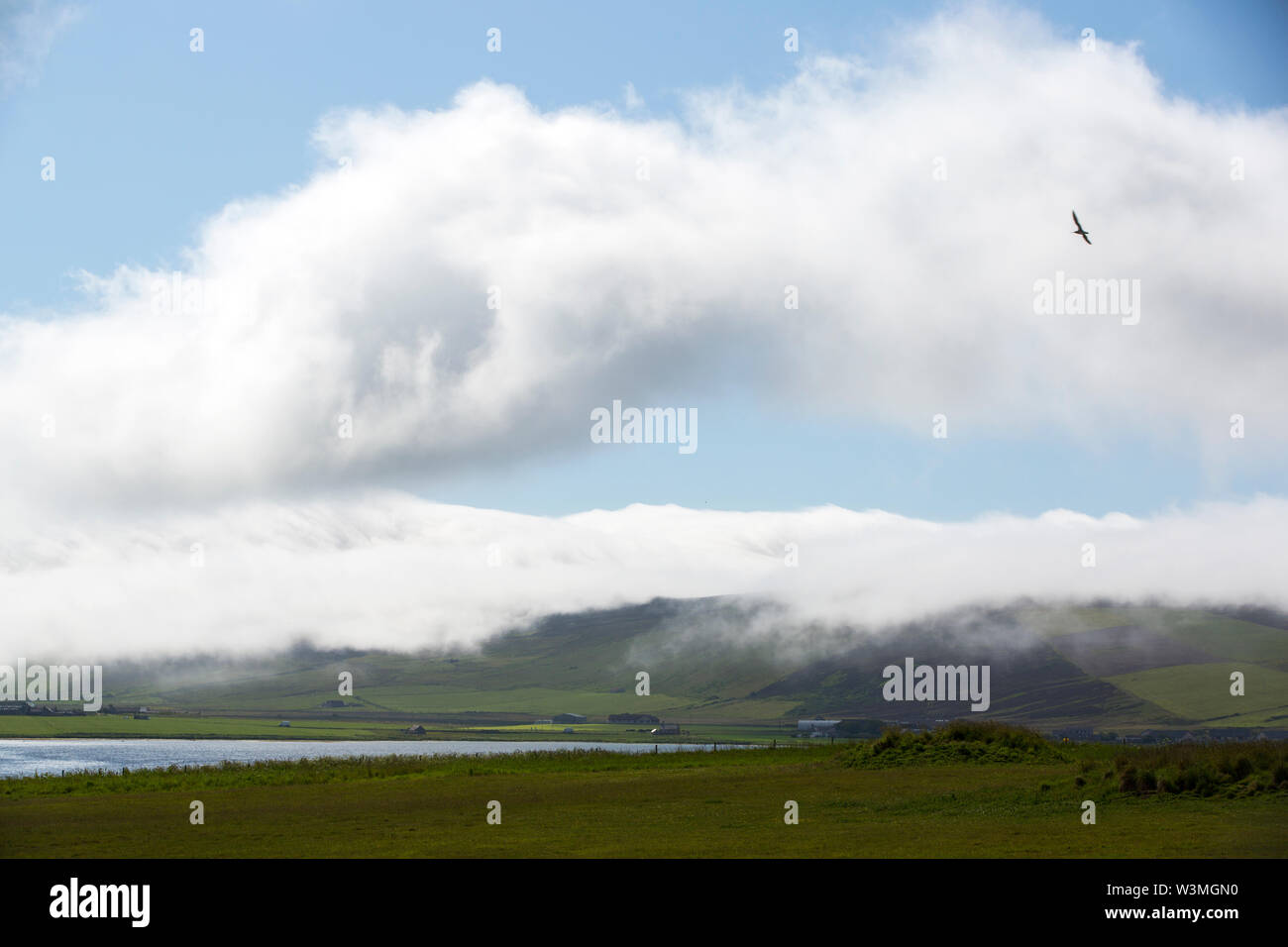 Sea Haah draped over the hills on mainland Orkney from the Stenness, Scotland, UK. - Stock Image