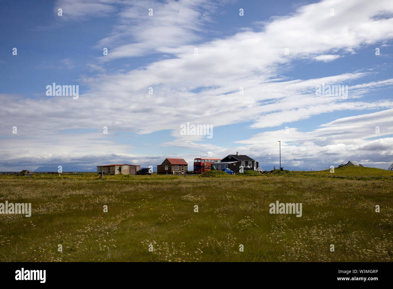 Small holding with red london bus in Sandgerdi south west iceland - Stock Image