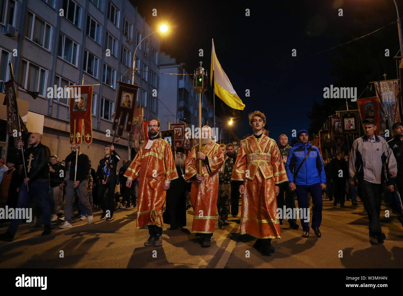 Yekaterinburg, Russia. 17th July, 2019. YEKATERINBURG, RUSSIA - JULY 17, 2019: Members of the clergy take part in a religious procession in memory of the Russian royal family from the Church of All Saints in Yekaterinburg to the Ganina Yama Monastery in the Sverdlovsk Region. Emperor Nicholas II of Russia and his family were executed on July 17, 1918. The procession is held as part of the Tsar Days Orthodox Culture Festival. Donat Sorokin/TASS Credit: ITAR-TASS News Agency/Alamy Live News - Stock Image