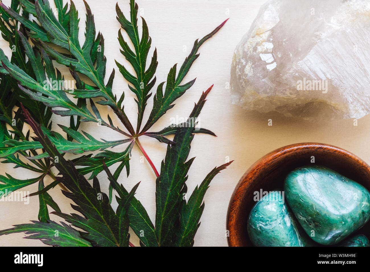 Chrysoprase with Quartz and Japanese Maple Leaves on Wood - Stock Image