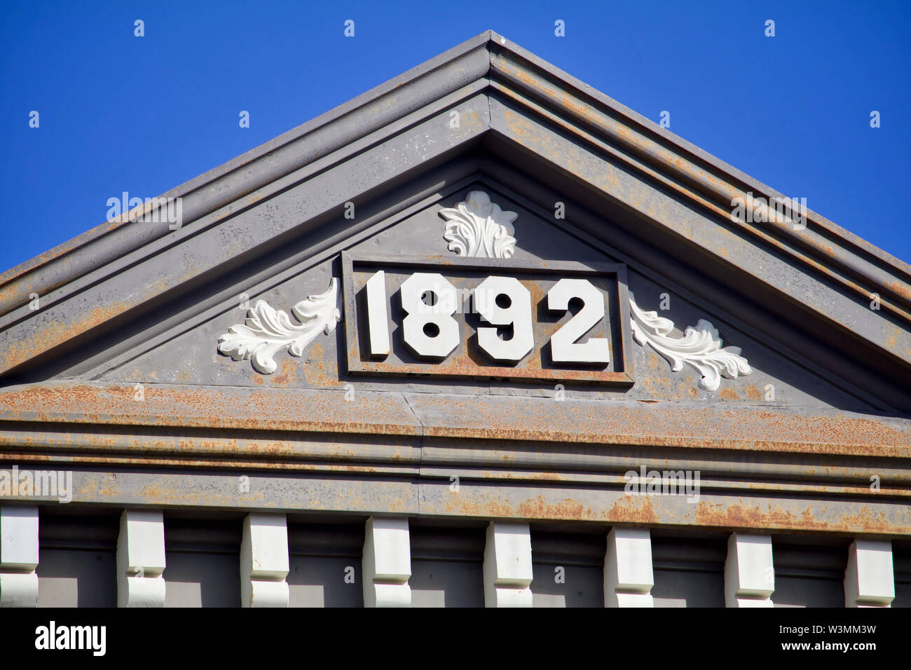The facade of a nineteenth century building shows. - Stock Image