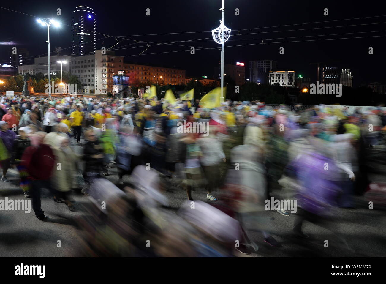 Yekaterinburg, Russia. 17th July, 2019. YEKATERINBURG, RUSSIA - JULY 17, 2019: Believers take part in a religious procession in memory of the Russian royal family from the Church of All Saints in Yekaterinburg to the Ganina Yama Monastery in the Sverdlovsk Region. Emperor Nicholas II of Russia and his family were executed on July 17, 1918. The procession is held as part of the Tsar Days Orthodox Culture Festival. Donat Sorokin/TASS Credit: ITAR-TASS News Agency/Alamy Live News - Stock Image