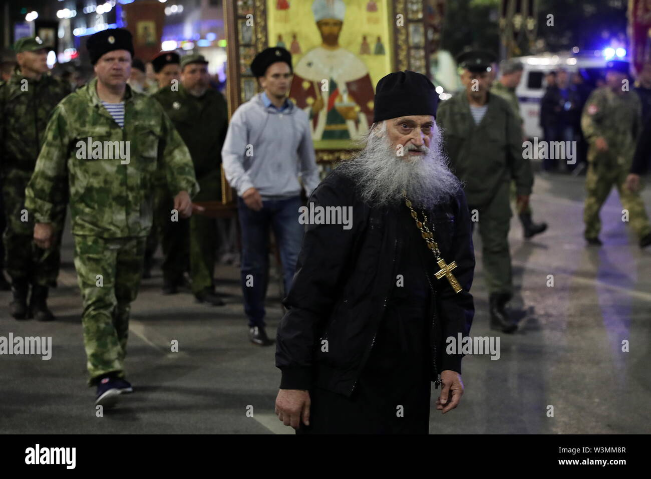 Yekaterinburg, Russia. 17th July, 2019. YEKATERINBURG, RUSSIA - JULY 17, 2019: A member of the clergy takes part in a religious procession in memory of the Russian royal family from the Church of All Saints in Yekaterinburg to the Ganina Yama Monastery in the Sverdlovsk Region. Emperor Nicholas II of Russia and his family were executed on July 17, 1918. The procession is held as part of the Tsar Days Orthodox Culture Festival. Donat Sorokin/TASS Credit: ITAR-TASS News Agency/Alamy Live News - Stock Image