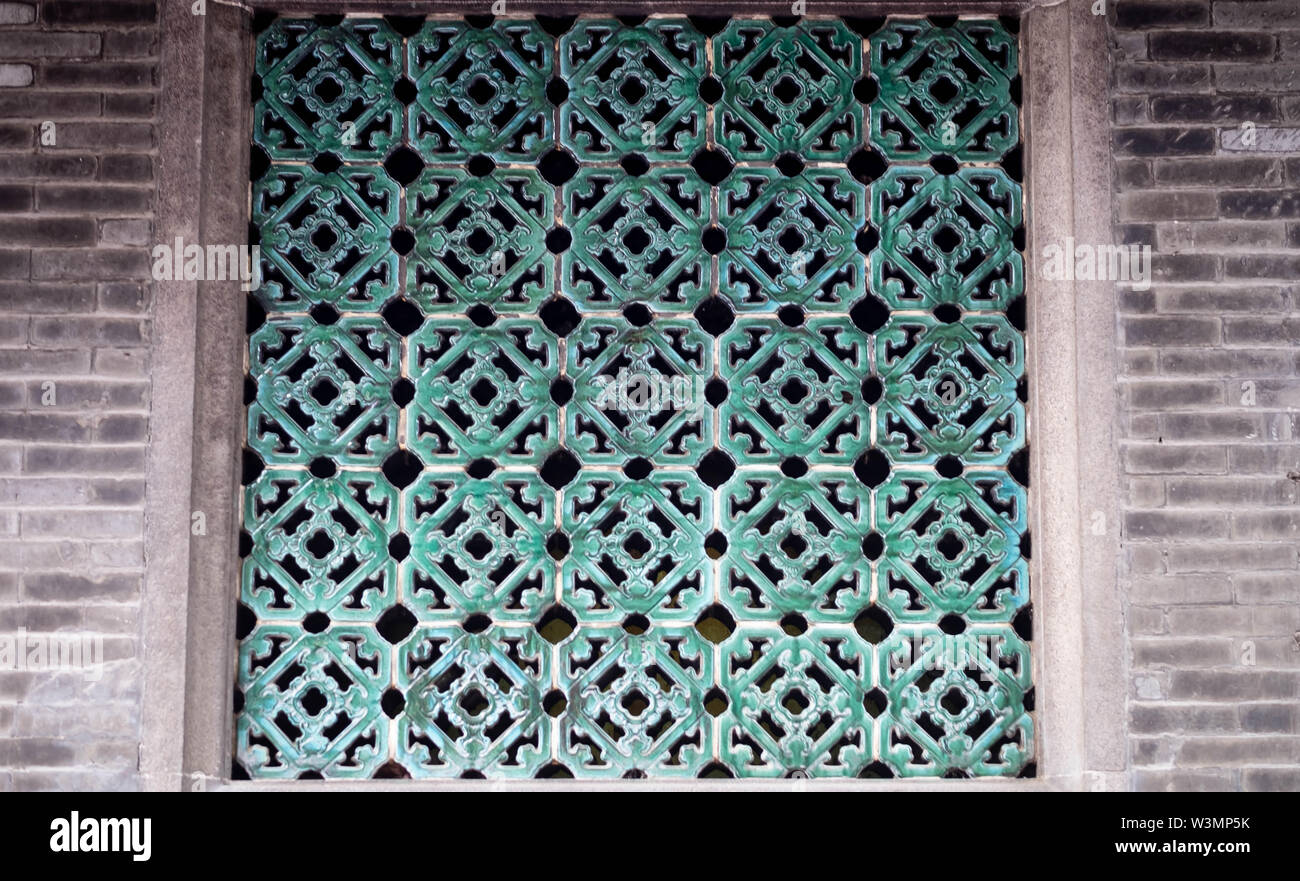 The tradition crafting tile on the windows, beside the tile is the ciements. It's a Old Chinese style. - Stock Image