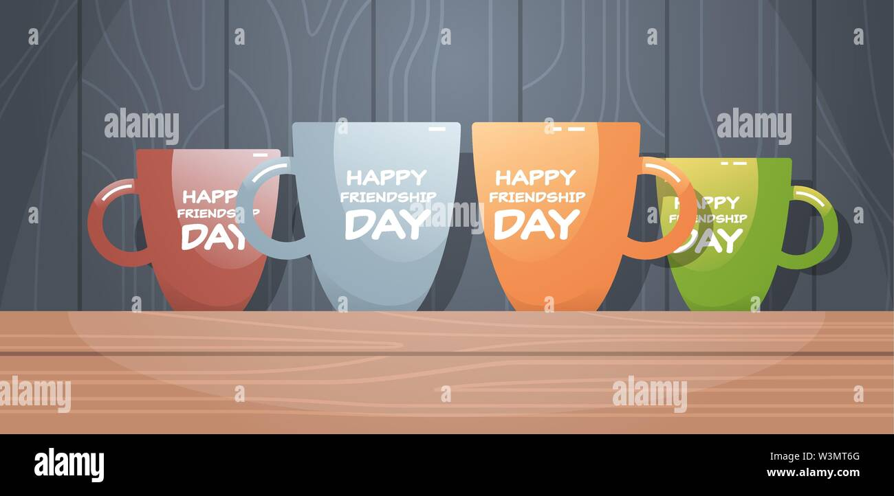 colorful cups on wooden table with text happy friendship day celebration concept flat horizontal - Stock Image