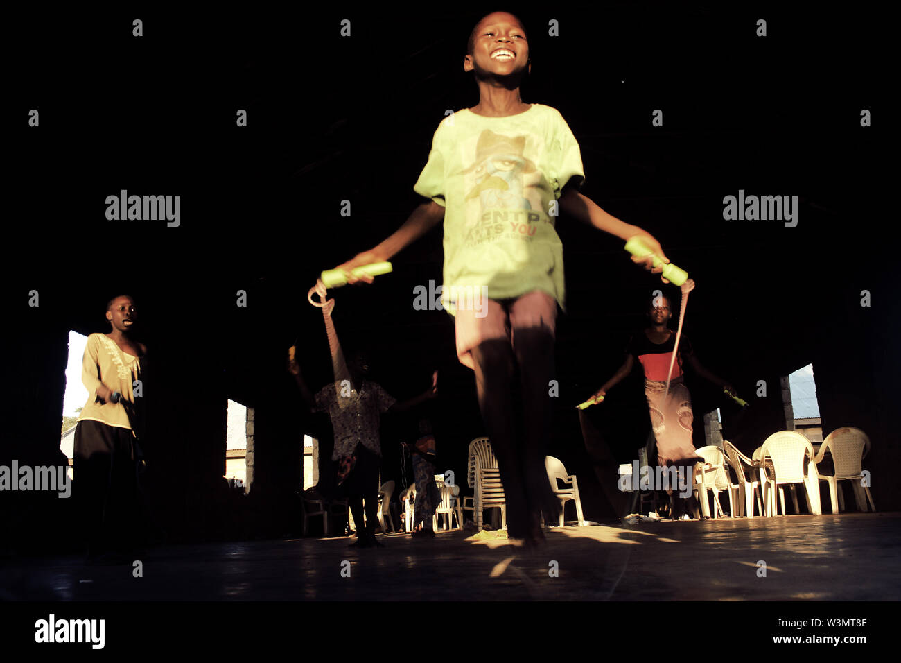 Children participate in skipping at the Deeper Life Camp Ground, where locally organized formal education was eventually stopped due to low turn-out of children of displaced persons. Many children of IDPs prefer psycho-social activities to formal education. - Stock Image