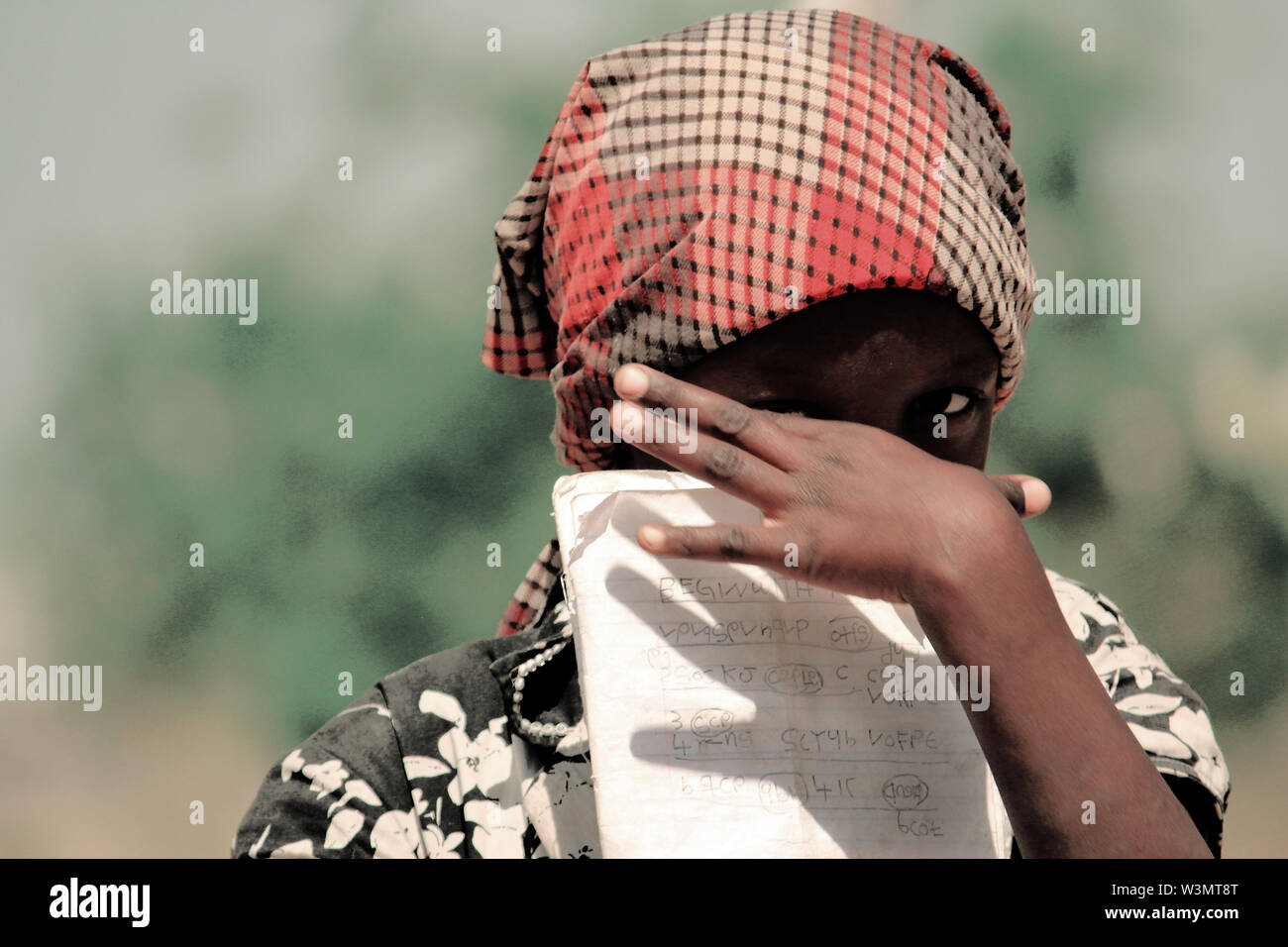 Father of Hauwa Muhammed, nine years old, was slaughtered by members of Boko Haram. Although Hauwa, her two other siblings and her mother escaped from Borno to Adamawa, like many other displaced children, learning in school is difficult because of her occasional traumatic state of mind. - Stock Image