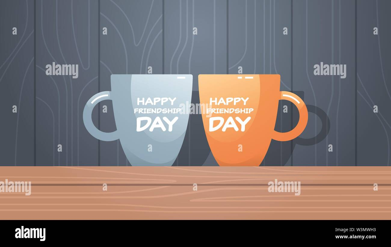 two cups on wooden table with text happy friendship day celebration concept flat horizontal - Stock Image