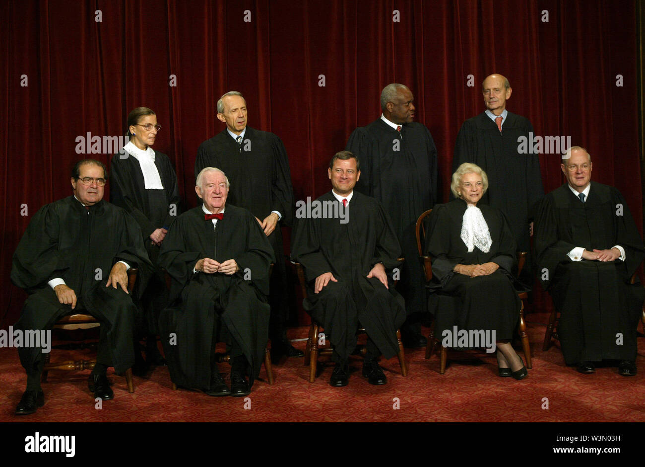 July 16, 2019 - Washington, District of Columbia, USA - Washington, DC - October 31, 2005 -- The Supreme Court justices pose for their official photograph at the United States Supreme Court in Washington, DC on October 31, 2005. Left to right bottom row: Associate Justices Antonin Scalia, John Paul Stevens, Chief Justice John G. Roberts, Jr., Associate Justices Sandra Day O'Connor and Anthony M. Kennedy. Top Row: Associate Justices Ruth Bader Ginsburg, David H. Souter, Clarence Thomas, and Stephen G. Breyer. Credit: Dennis Brack - Pool via CNP (Credit Image: © Dennis Brack/CNP via ZUMA - Stock Image