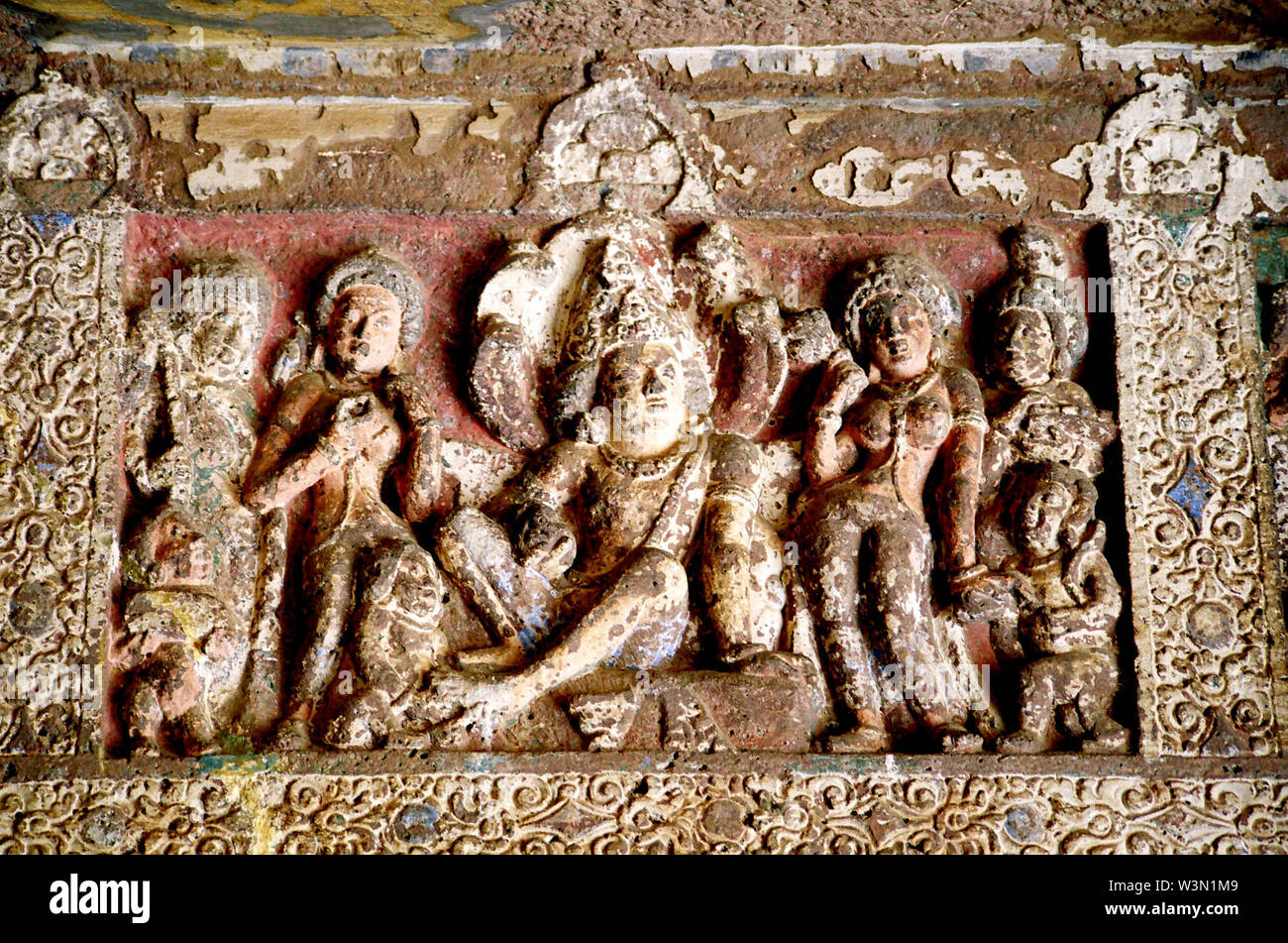 Stone carving at Ajanta caves, Maharashtra, India. The 29 Buddhist caves were excavated between the 2nd century B.C and the 1st A.D., and the 4-7th A.D. but they were not discovered until 1819, approximately 150 years ago by a British officer. The 29 caves contain outstanding paintings depicting the life and times of Buddha are good examples of ancient Indian art. The wall paintings, sculptures and architecture of Ajanta are celebrated as one of the true wonders of the ancient world. August 18, 2007. - Stock Image