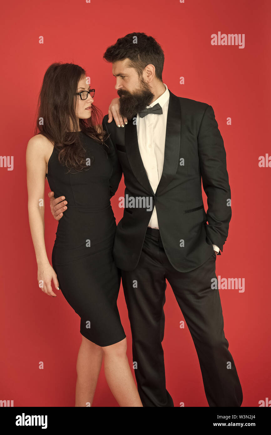 Gorgeous couple in love. Award ceremony concept. Bearded gentleman wear tuxedo girl elegant dress. Formal dress code. Visiting event or ceremony. Couple ready for award ceremony. Corporate party. - Stock Image