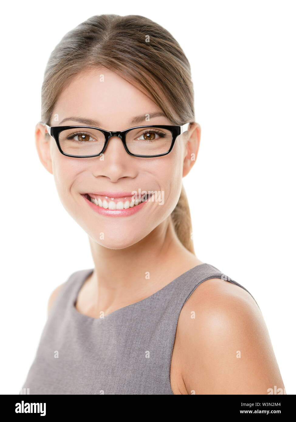 Glasses eyewear spectacles woman happy looking at camera with big smile. Close up portrait of female business woman model face isolated on white background. Mixed race Asian Caucasian businesswoman. - Stock Image