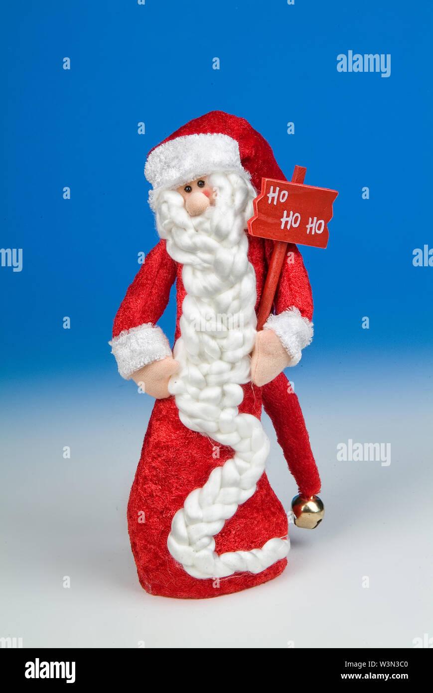 Santa Klaus statuette on a studio background - Stock Image