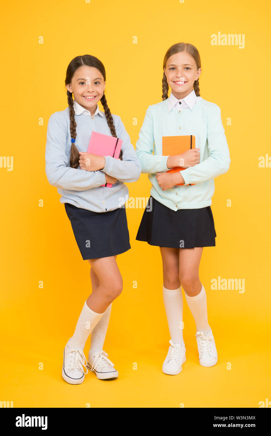 Studying english literature  Little girls holding books of